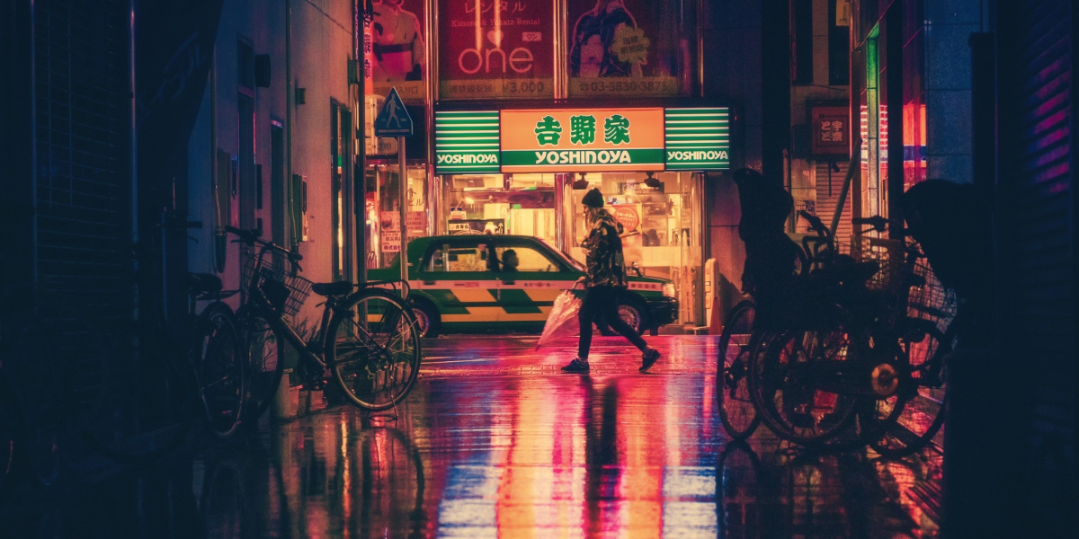 Woman walking street at night. Credit:Pexels