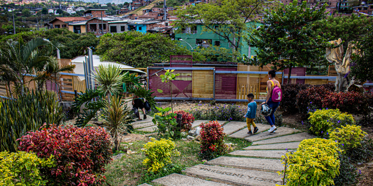 man walks child to school in Medellin