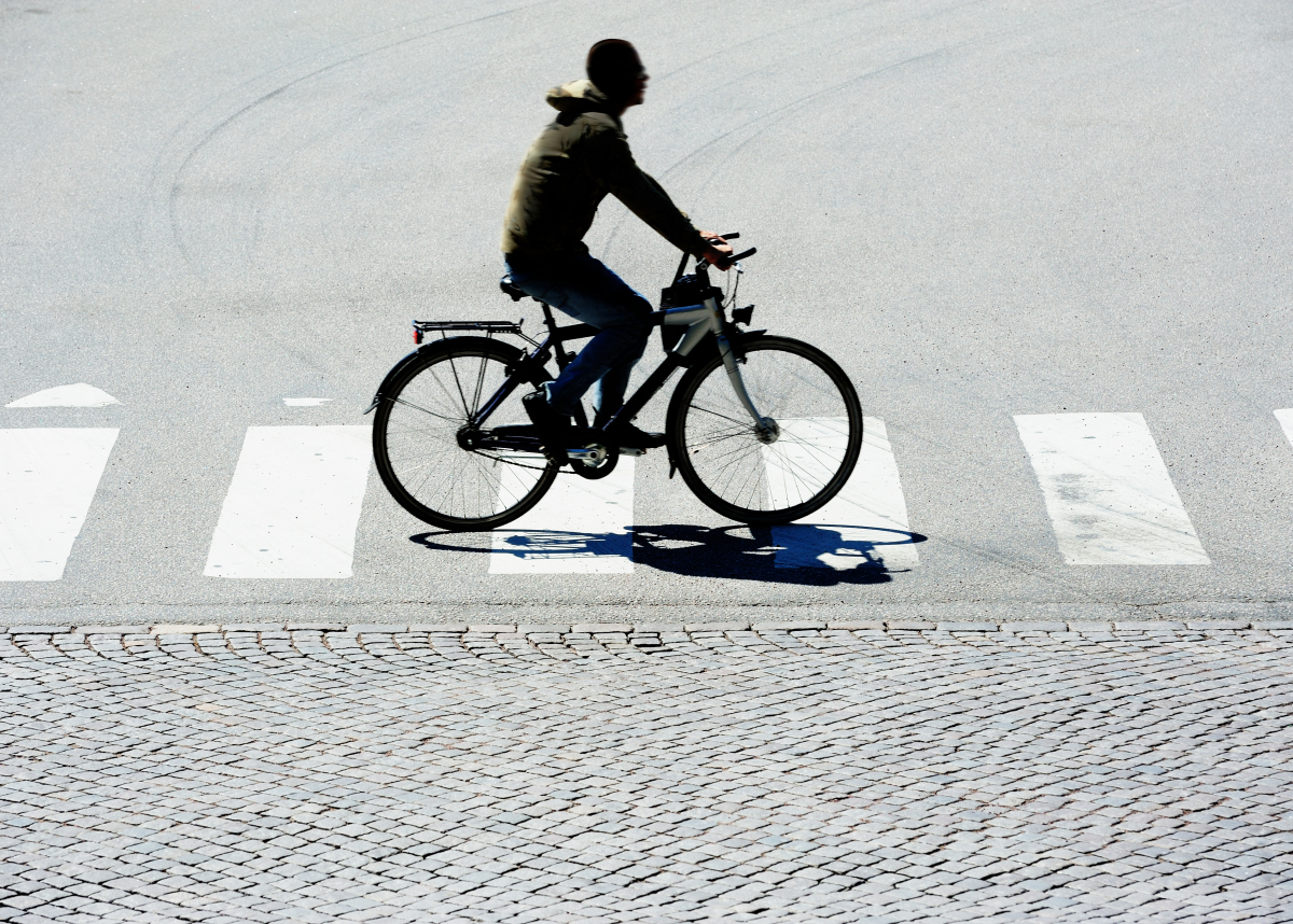 Man cycling on pedestrian crossing.Credit Olaser