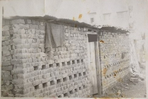 Shakuntala's shanty next to a city drain (1970s)